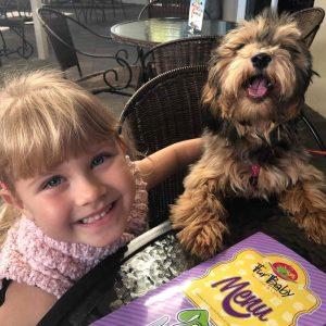 Girl and Dog at Cafe
